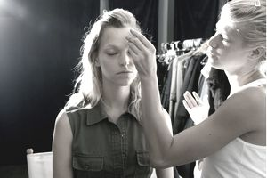 Female model being made-up before fashion show