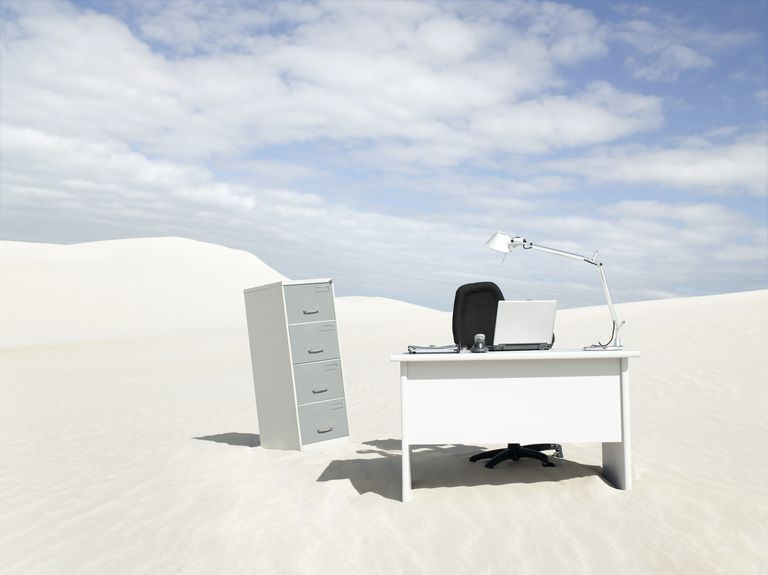 An empty desk in the middle of a desert