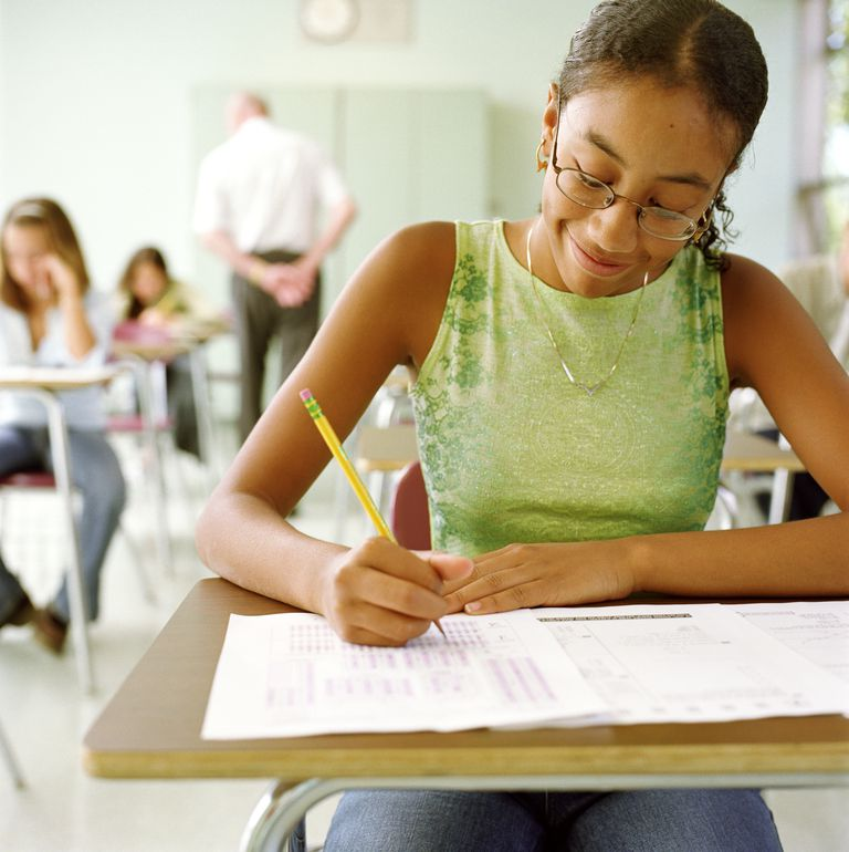 Teenage girl taking test in class