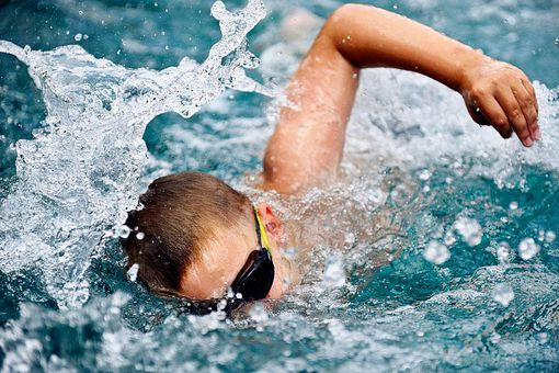 Boy swimming close up