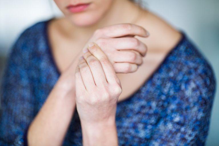 Woman grabbing her wrist in pain