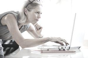 Businesswoman using laptop computer at desk