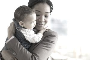 Mixed race woman hugging baby