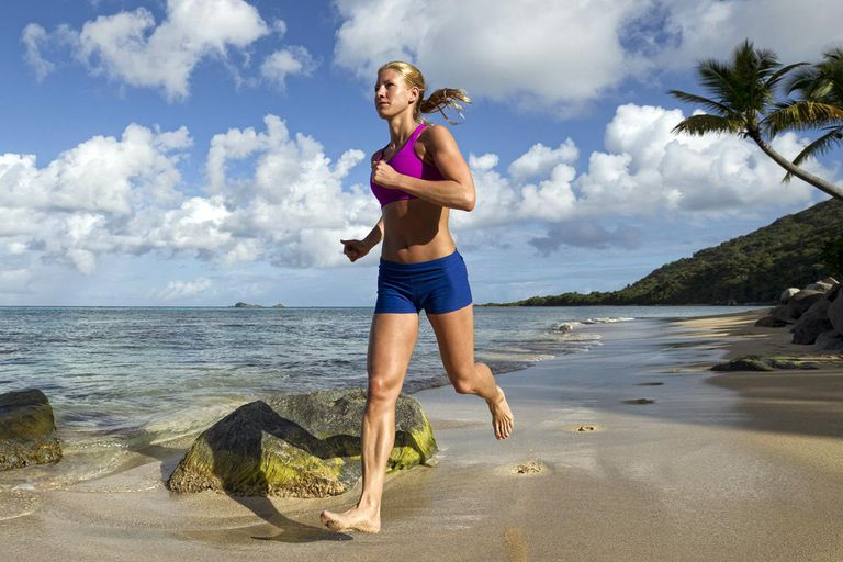 A woman running on the beach