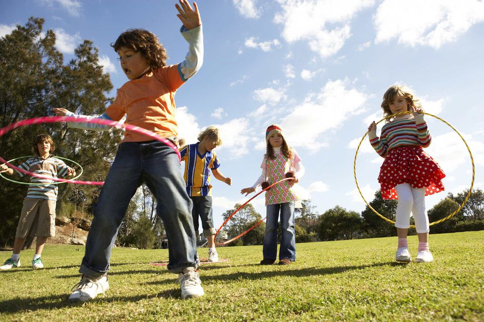 A picture of kids playing outdoors with hula hoops