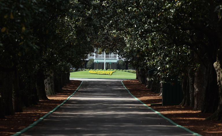 Magnolia Lane's 60 magnolia trees and the clubhouse are seen at Augusta National Golf Club