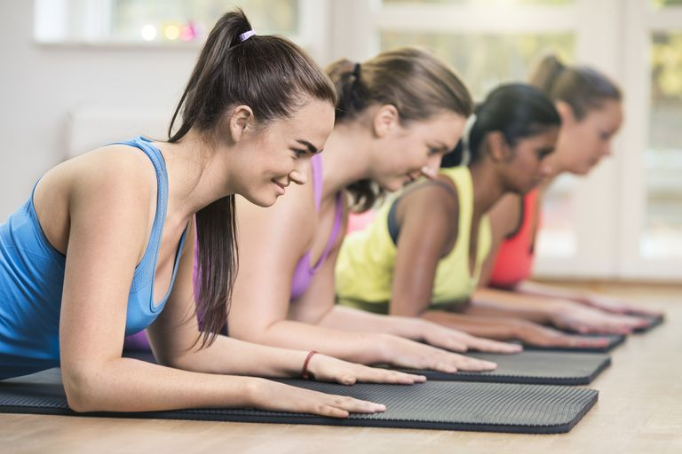Four women exercising in gym