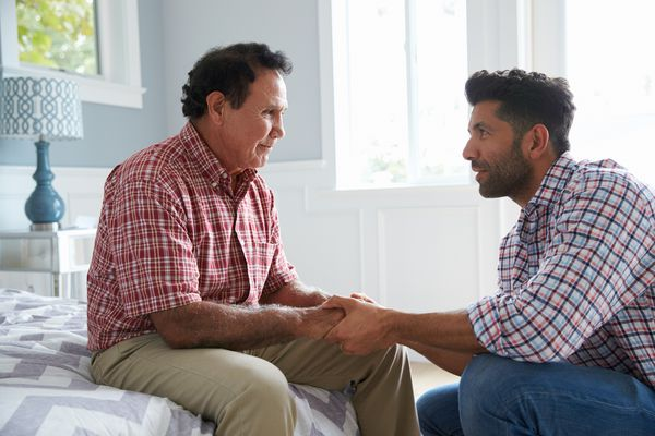 Man and father having conversation
