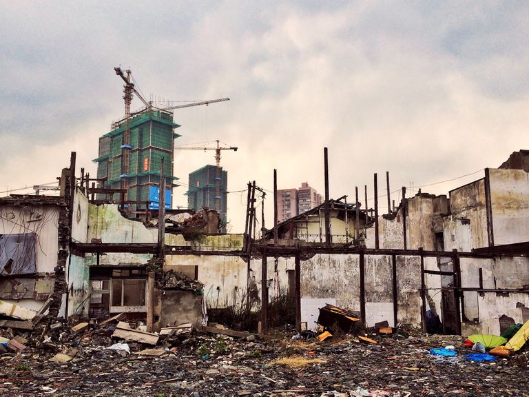 Demolished House Against Incomplete Building In City