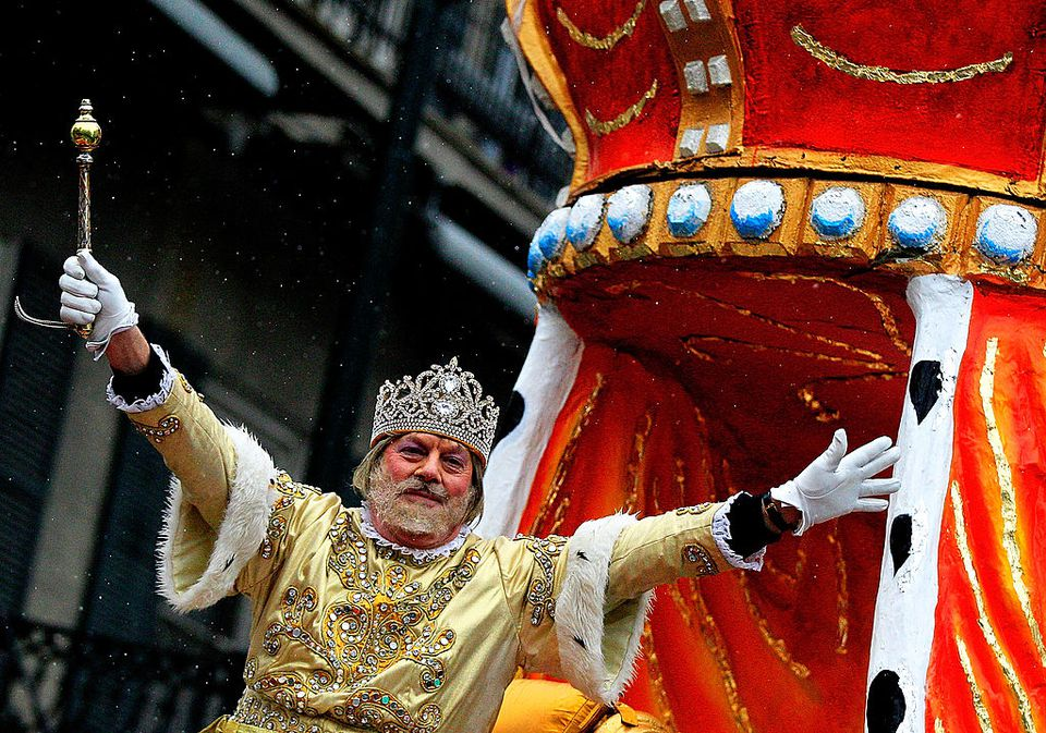 A parade participant in a Mardi Gras Parade.