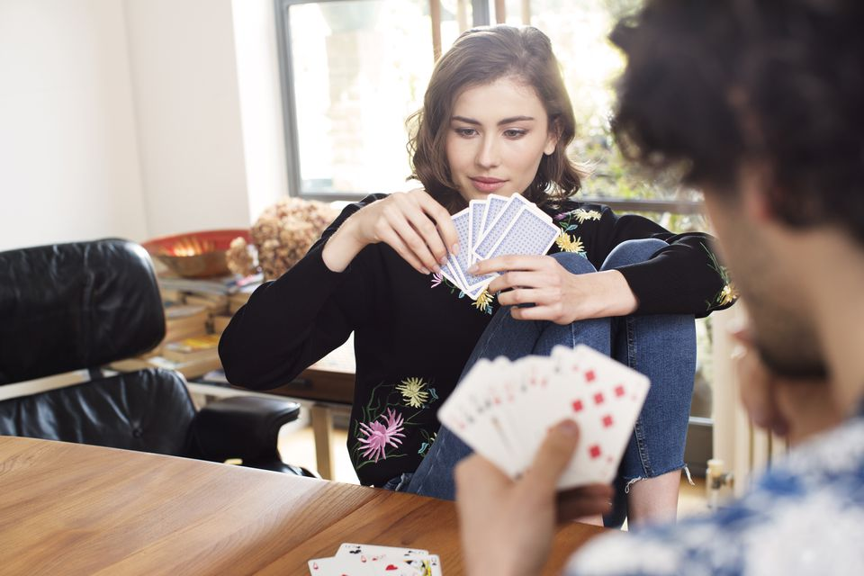 Young couple playing cards
