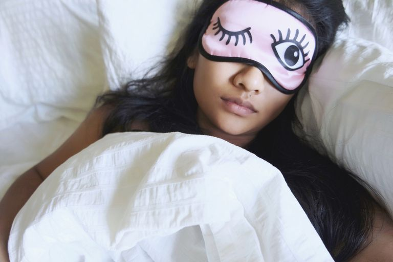 Woman sleeping with a sleep mask