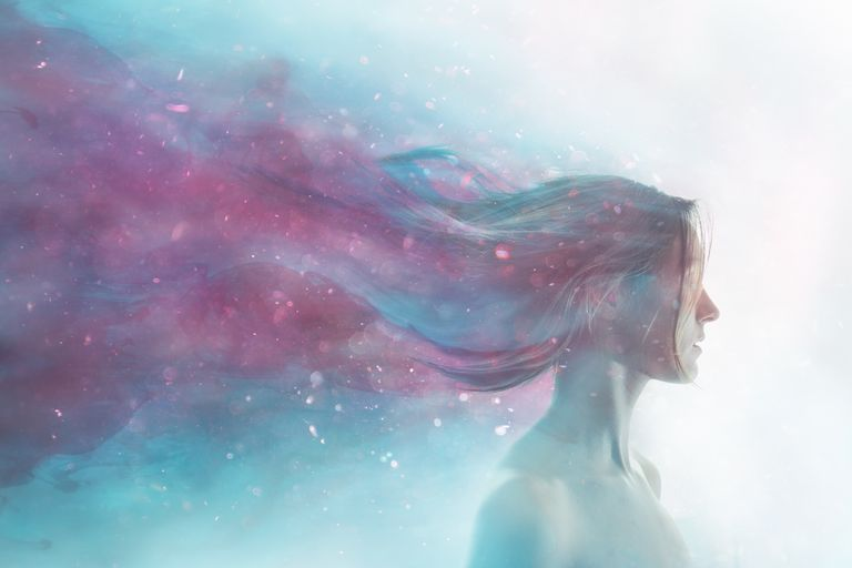 Portrait of girl merged with cosmos