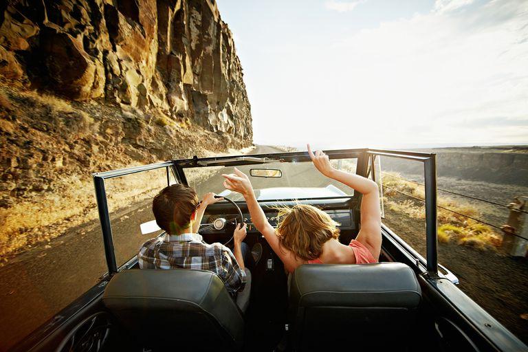 Hands up in convertible truck