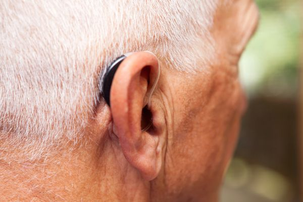 Senior Man's Ear with Hearing Aid