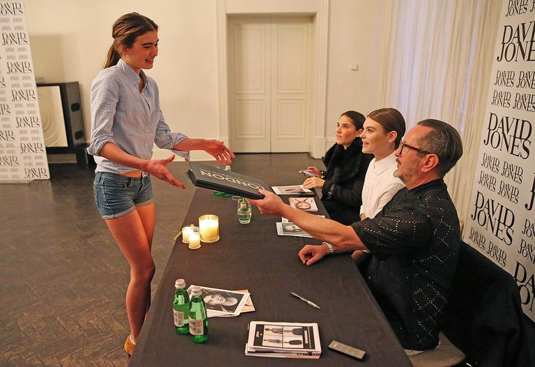 A model shows her book to judges during casting