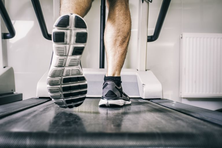 Close up of man's feet on a treadmill
