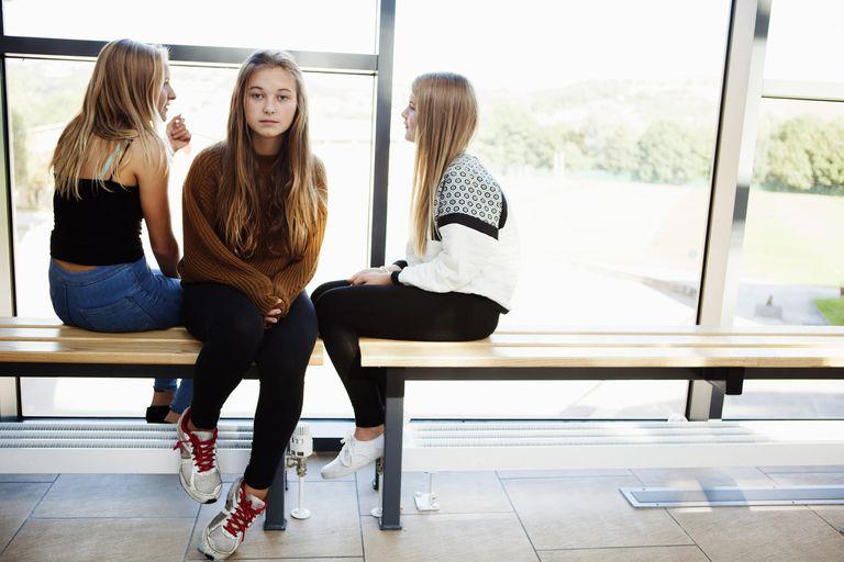Isolated teenage schoolgirl in corridor