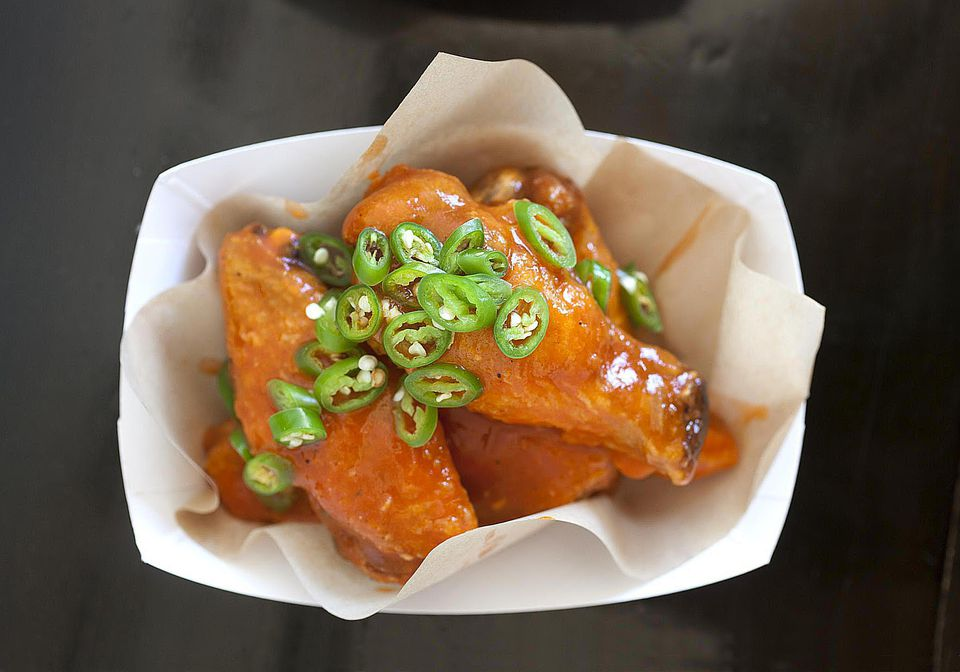 Fried chicken wings smothered in spicy buffalo bbq sauce