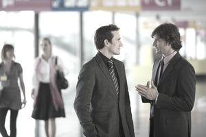Businessmen talking in conference center