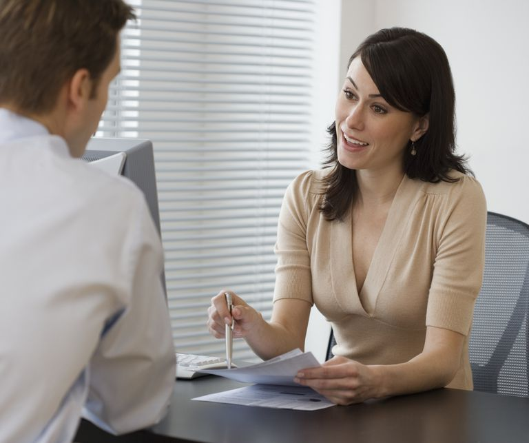 HR manager provides an executive with feedback in her role as coach