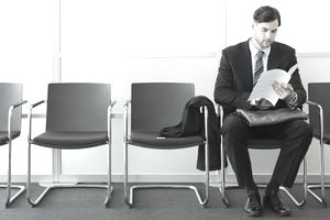Man holding resume in waiting room