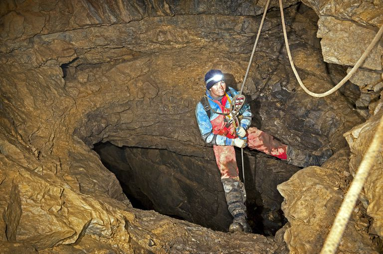 a caver down in a cave