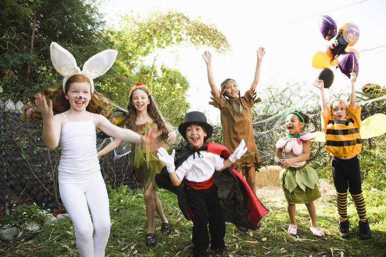 Excited children in Halloween costumes