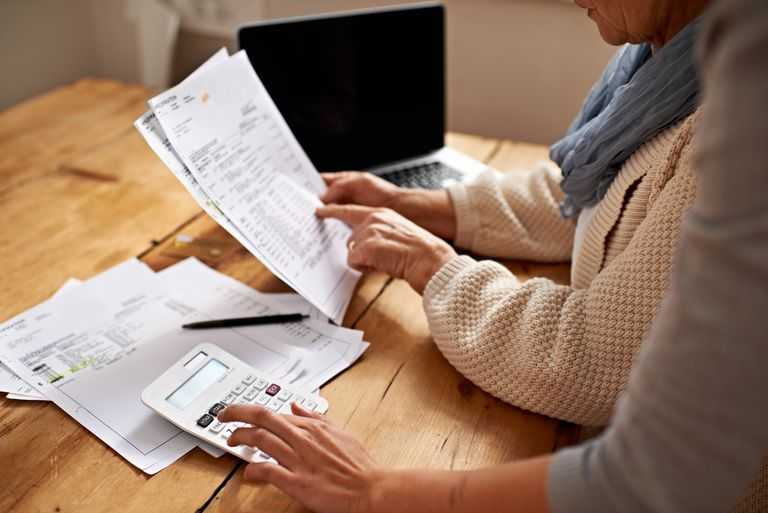 Woman holding taxation documents