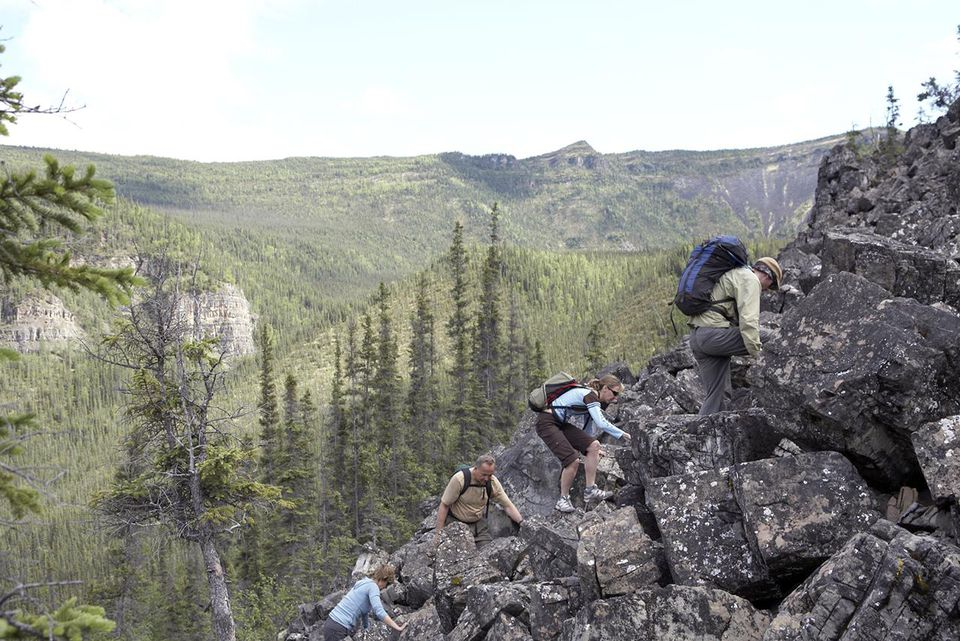Hikers climbing rocky area