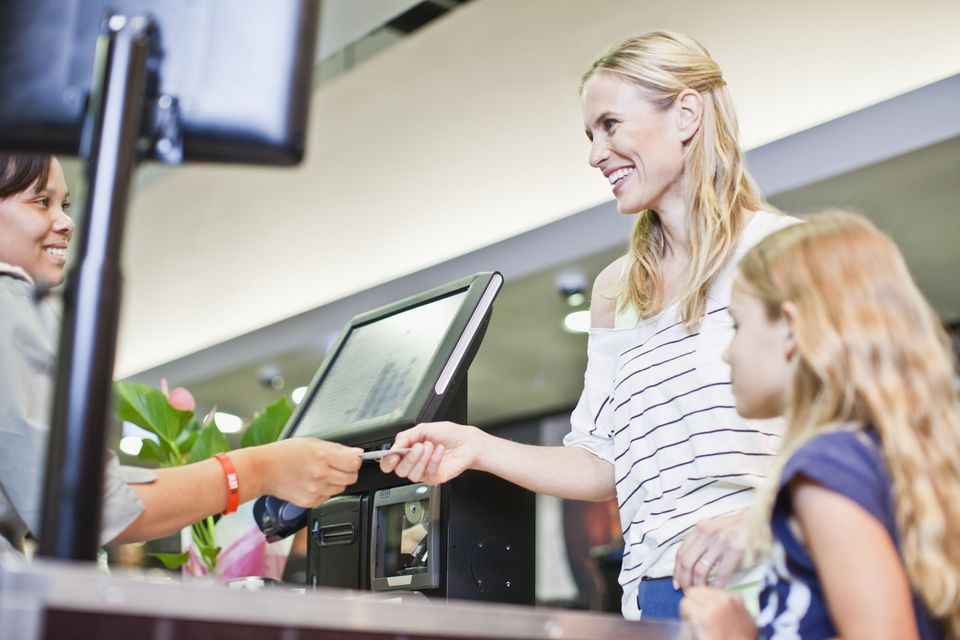 A picture of a woman paying a cashier