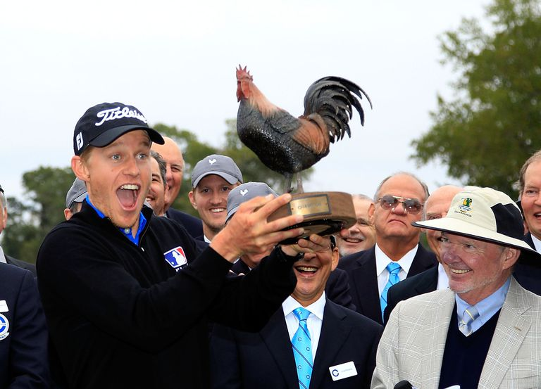 Peter Malnati hoists the trophy following a victory at the Sanderson Farms Championship on November 9, 2015