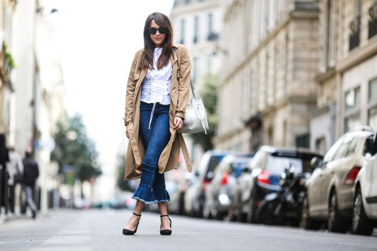 Street style in jeans and trench coat
