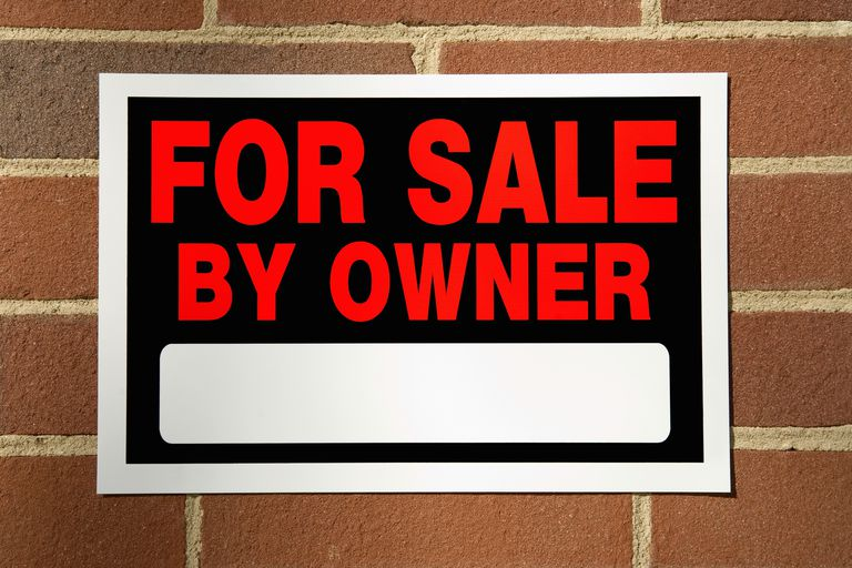 For Sale sign on brick wall