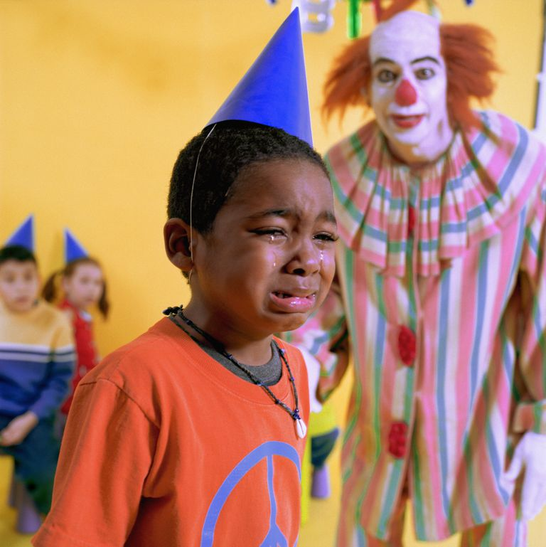 clown making child cry