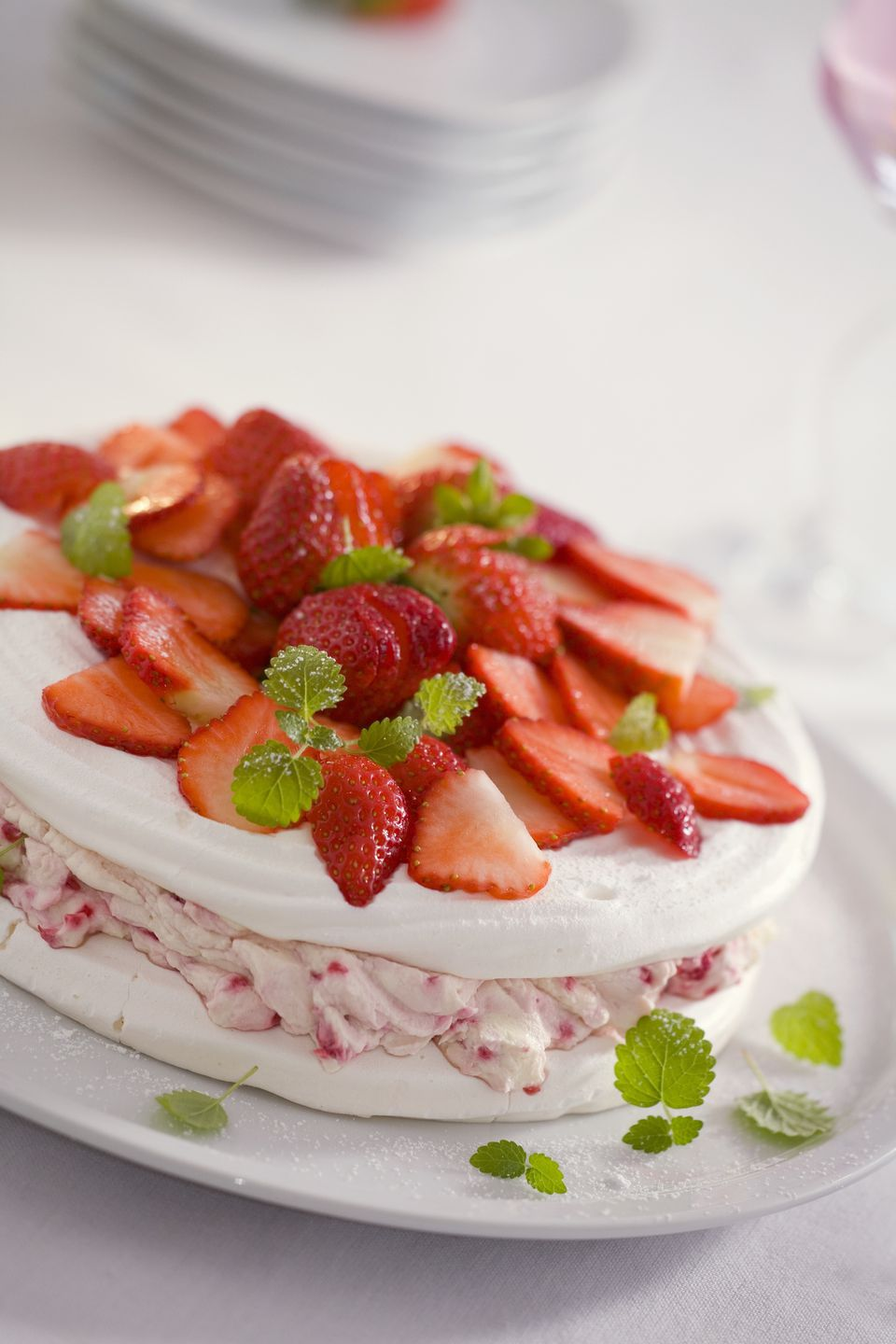 Meringue cake with strawberry cream and fresh strawberries