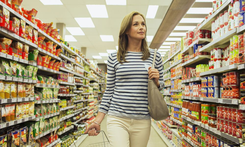 Woman shopping in grocery store aisle