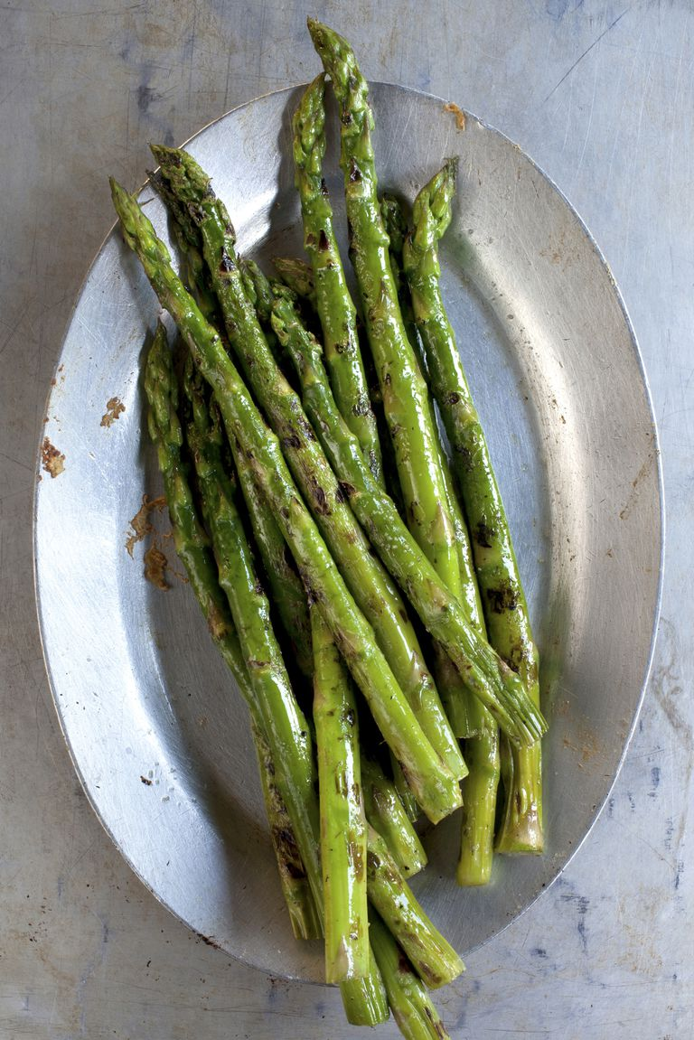 Close up of plate of grilled asparagus