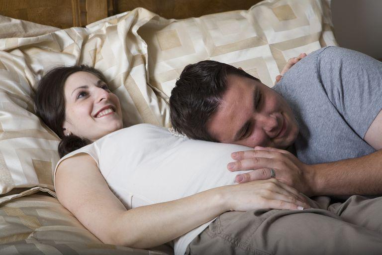 Partner Holding Mom's Pregnant Abdomen