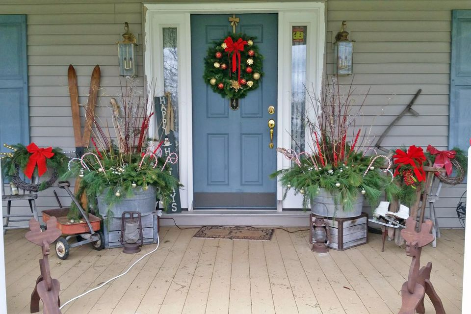 Rustic holiday porch with tub planters
