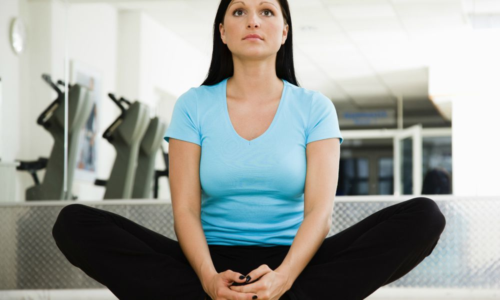Woman doing a groin stretch
