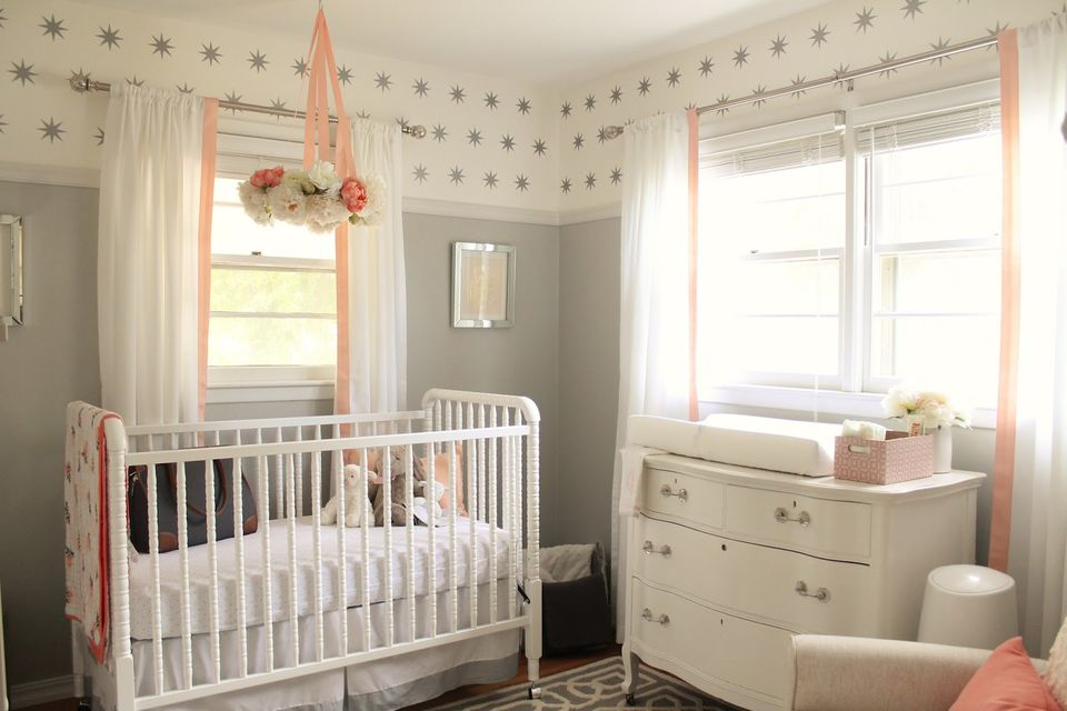 Grey, white, and pink nursery space