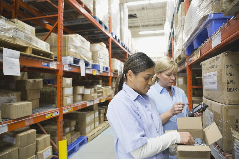 Workers picking inventory in a warehouse