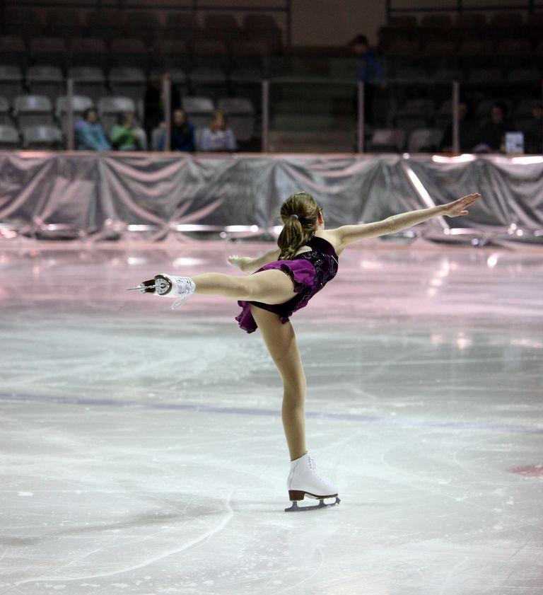 Figure Skater skates spiral away from Camera
