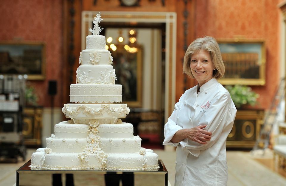 Fiona Cairns stands next to the Royal Wedding cake that she and her team at Fiona Cairns Ltd of Leicestershire made for Prince William and Catherine Middleton's wedding.