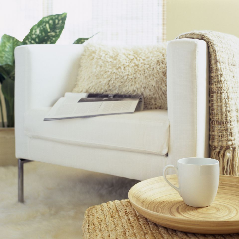 Mug by armchair in living room