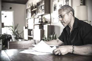 Man looking at 401k paperwork