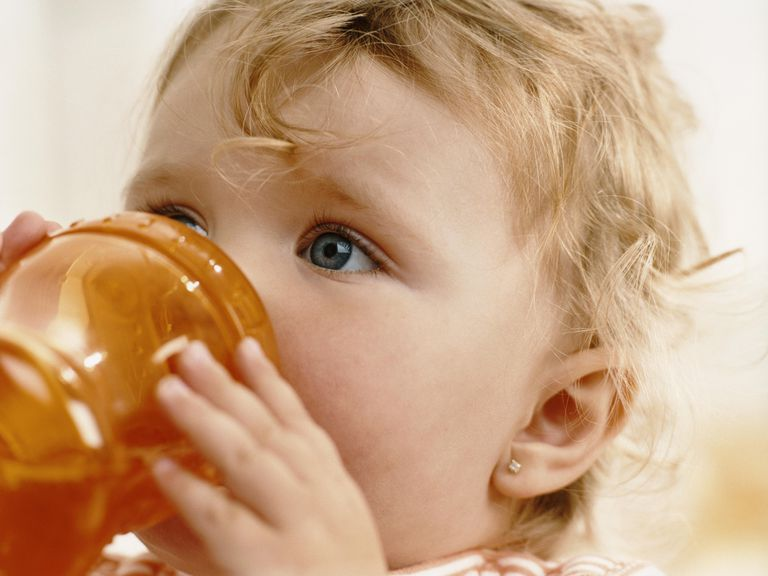 Infant Girl Drinking From a Cup