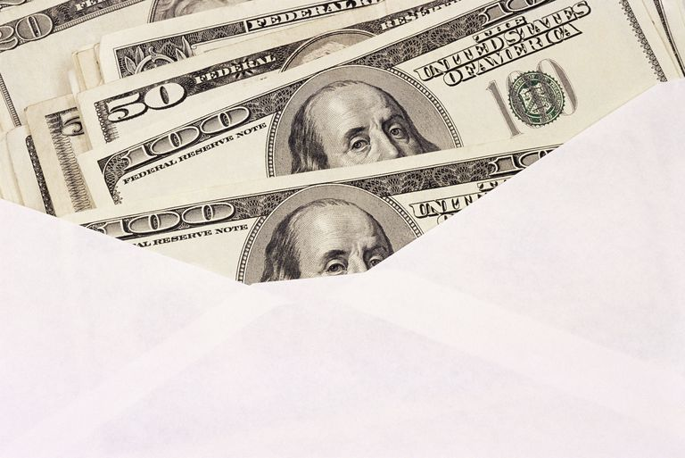 Dollar bills in an envelope