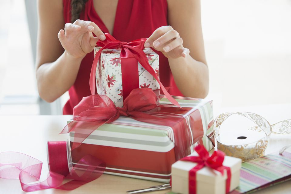 woman wrapping holiday gifts